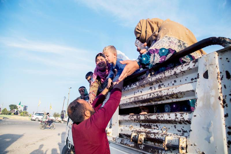 Syrians fleeing Turskih advance arrive to the town of Tal Tamr in north Syria, Monday, Oct. 14, 2019. Syrian government troops moved into towns and villages in northern Syria on Monday, setting up a potential clash with Turkish-led forces advancing in the area as long-standing alliances in the region begin to shift or crumble following the pullback of U.S. forces. (AP Photo/Baderkhan Ahmad)  DV105