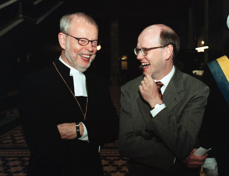 2000, första kyrkomötet efter skilsmässan. Ärkebiskop K G Hammar och kyrkominister Thomas Östros (S).